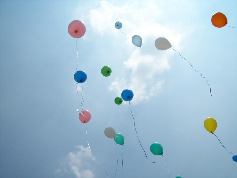 Balloons flying.